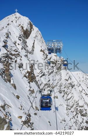 cable gondolas in alps mountains - stock photo