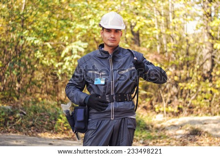 Cable guy holding optical cable - stock photo