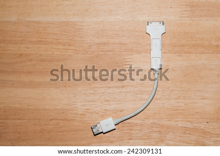 cable on wood background - stock photo