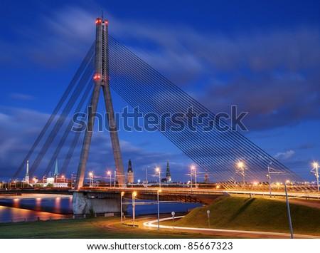 Cable-stayed bridge across Daugava river in Riga, Latvia. - stock photo