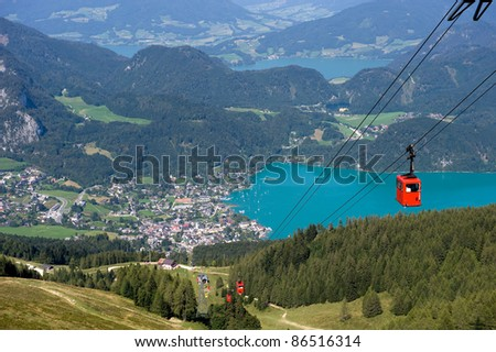 Cable way that goes on to the top of the zwolferhorn mountain near the Wolfgangsee in Austria - stock photo