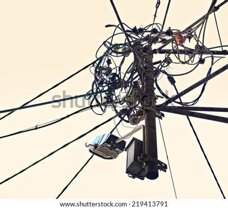 Cables and wires order and chaos on the vintage background - stock photo