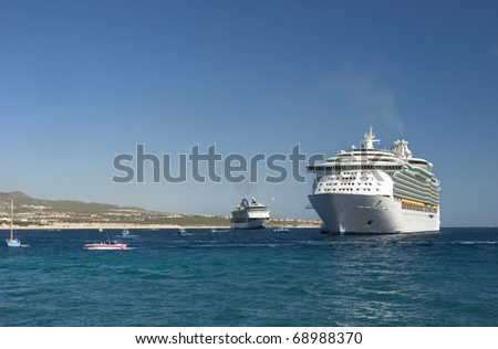 Cabo San Lucas, Mexico. Two cruiseships and recreational boats. The beach and condominiums are in the background. - stock photo