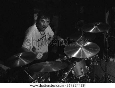 CABO SAN LUCASOCTOBER 98:Drummer David Lauser performs Circa October 1998 at the Cabo Wabo Cantina in Cabo San Lucas, Mexico. - stock photo