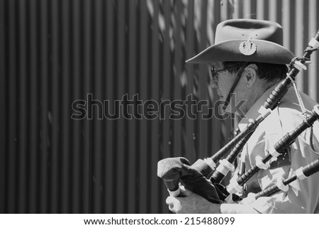 CABOOLTURE, AUSTRALIA -SEPTEMBER 06: Unidentified bagpiper as part of ANZAC centenary commemoration at historical village September 06, 2014 in Caboolture, Australia - stock photo