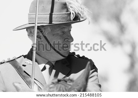 CABOOLTURE, AUSTRALIA -SEPTEMBER 06: Unidentified re-enactor from 11th Lighthorse Association as part of ANZAC centenary commemoration at historical village September 06, 2014 in Caboolture, Australia - stock photo