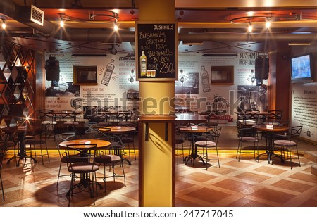 Cacak, Serbia - January 23, 2015: Velvet Cafe and Club interior, modern design with vintage chairs and tables and illustrative wallpapers.