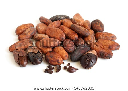 Cacao beans on a white background - stock photo