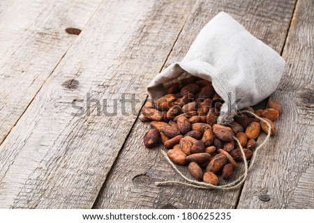 cacao beans on wooden background - stock photo