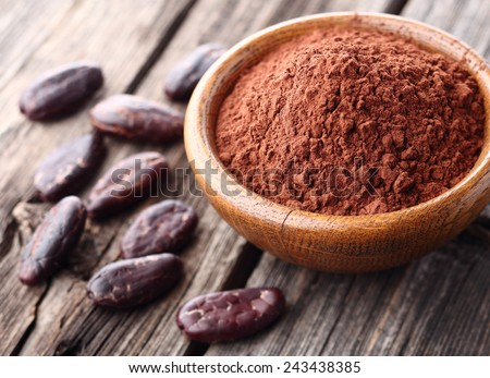 Cacao powder with cacao beans - stock photo