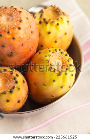 Cactus pears on table, close up. - stock photo