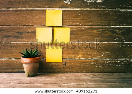 cactus,Plant,post-it ,note ,Sticky Note on Wood Table Background, Rustic Still Life Style iew with copy space - stock photo