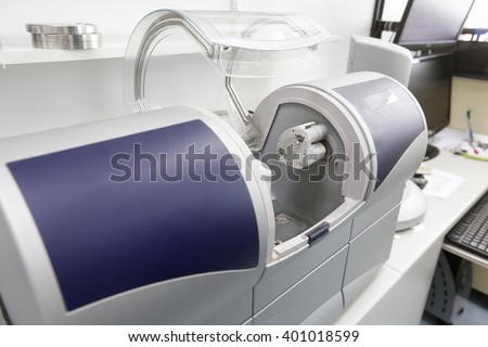 CAD/CAM dental computer-aided machine in a highly modern dental laboratory for prosthesis and crowns milling. Dentistry, prostodontics, prosthetics and medical computer technology concept.    - stock photo