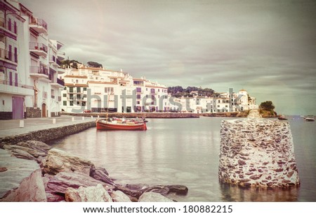 Cadaques, Costa Brava, Catalonia, Spain: afternoon landscape with houses and old harbour. - stock photo