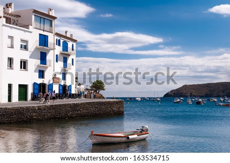 Cadaques seaside buildings and docked boats - Spain - stock photo