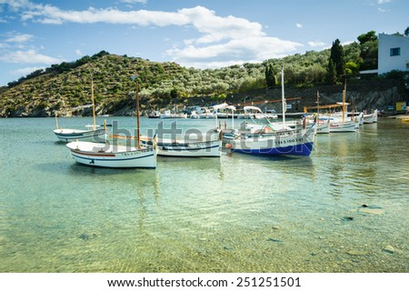 CADAQUES, SPAIN - JULY 21: View of Cadaques, one of the most touristic villages of Costa Brava, on July 21, 2014, in Port de la Selva,Spain. It is on a bay in the middle of the Cap de Creus peninsula. - stock photo