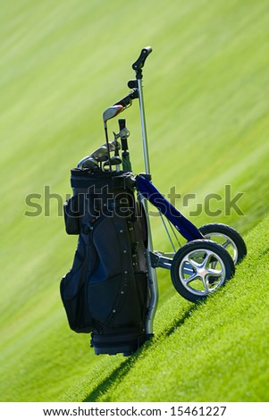 caddy on a golf field - stock photo