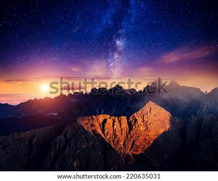 Cadini di Misurina range and Sorapis group under starry light in Natural park Tre Cime di Lavaredo. Dolomites, South Tyrol. Location Auronzo, Italy, Europe. Astrophotography. Beauty world.  - stock photo