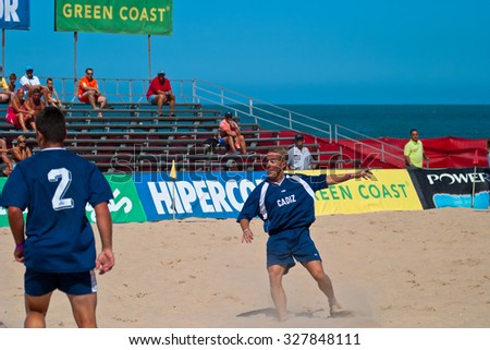 CADIZ, SPAIN -  JUL 30:  Unknown players of the team of Cadiz playing the Spanish Championship of Beach Soccer on Jul 30, 2005 on the beach of La Victoria in Cadiz, Spain - stock photo