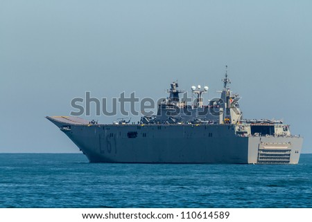 CADIZ, SPAIN-JUN 04: Aircraft carrier L-61 Juan Carlos I setting sail after taking part in an exhibition on the day of the spanish army forces on Jun 04, 2012, in Cadiz, Spain