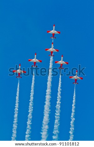 CADIZ, SPAIN-SEP 9: Aircrafts of the Patrulla Aguila take part in a test on the 4th airshow of Cadiz on Sep 9, 2011, in Cadiz, Spain