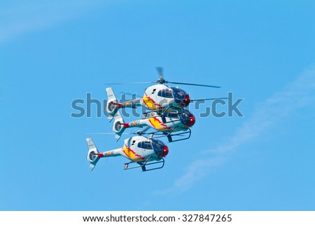 CADIZ, SPAIN-SEP 11: Helicopters of the Patrulla Aspa taking part in an exhibition on the 4th airshow of Cadiz on Sep 11, 2011, in Cadiz, Spain - stock photo