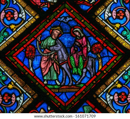 CAEN, FRANCE - FEBRUARY 12:  Stained glass window depicting Joseph, Mother Mary and Jesus in the cathedral of Caen, France, on February 12, 2013.  - stock photo