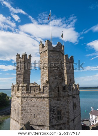 CAERNARFON, WALES - 29 SEPT. 2013: View on one of the polygonal towers of Caernarfon Castle. The castle is a major landmark in Wales and attracts thousands of tourists each year - stock photo