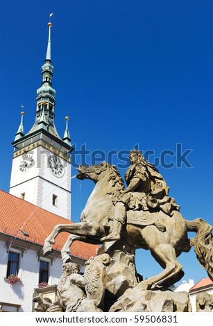 Caesar Fountain and Town Hall Clock Tower in Olomouc, Czech Republic - stock photo