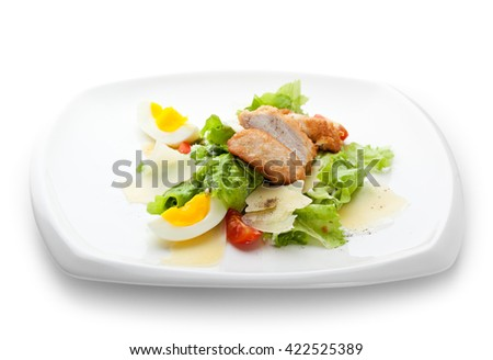 Caesar Salad dressed with Chicken Fillet, Salad Leaf, Croutons, Cherry Tomato, Eggs and Parmesan Cheese - stock photo