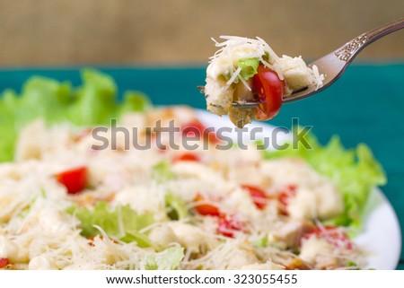Caesar Salad on a table - stock photo