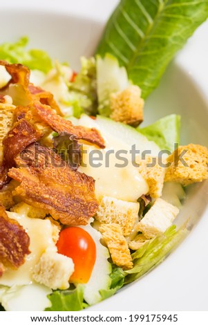Caesar Salad on white plate, close-up