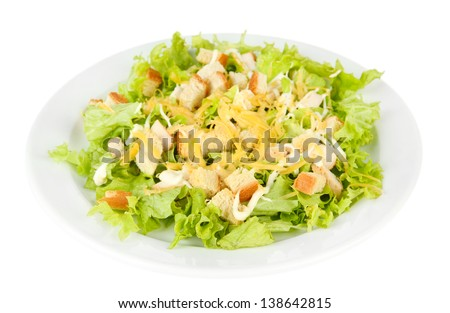 Caesar salad on white plate, isolated on white
