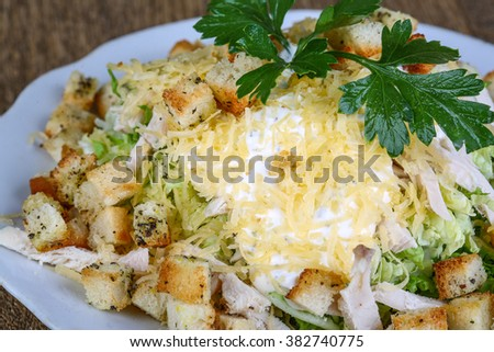Caesar salad served parsley on the wood background - stock photo