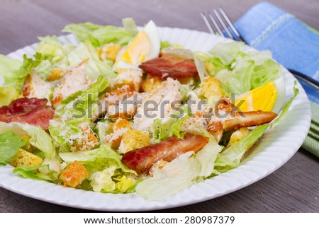 Caesar Salad with Chicken and Breadsticks