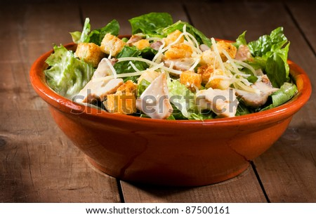 Caesar salad with chicken and greens - stock photo