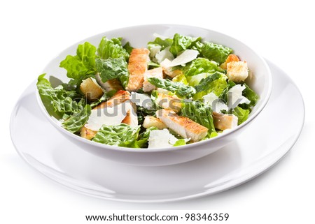 Caesar salad with chicken and greens on white background - stock photo
