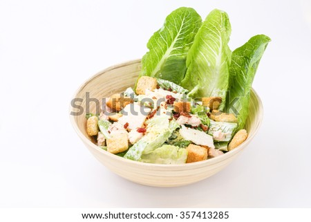 Caesar Salad with chicken, croutons and Parmesan - stock photo