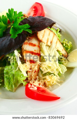 Caesar salad with chicken on white plate