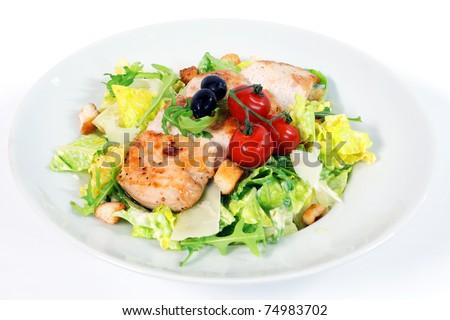 Caesar salad with chicken steak on white background - stock photo