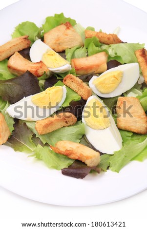 caesar salad with eggs Isolated on a white background.