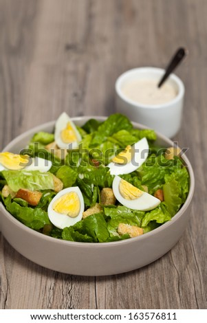 Caesar salad with eggs, lettuce, croutons and parmesan