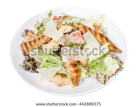 Caesar salad with grilled chicken and parmesan. Isolated on a white background.