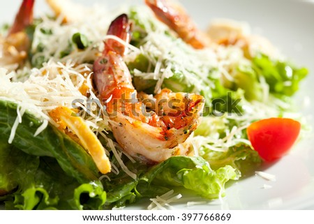 Caesar Salad with Grilled Shrimp and Parmesan Cheese - stock photo