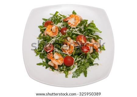 Caesar salad with shrimp. Top view on white background - stock photo