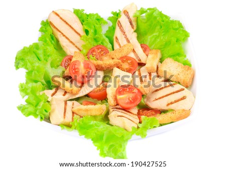 Caesar salad with tomatoes cherry. Isolated on a white background.