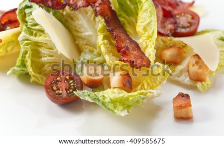 Caesar salad with tomatoes ,toasts  and bacon