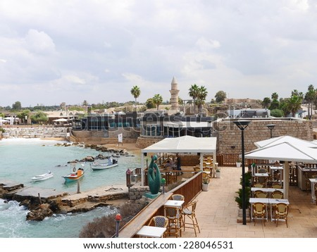 CAESAREA - september 20:Visitors at Caesarea ancient port on september 20 2014. The ancient Caesarea Maritima city and harbor was built by Herod - stock photo
