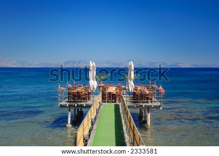 Café at open sea, Corfu island Greece - stock photo