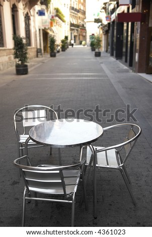 Cafe accessory into quiet small street - stock photo